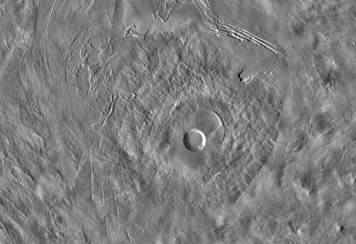 View of the Pavonis volcano with its large crater in the center.