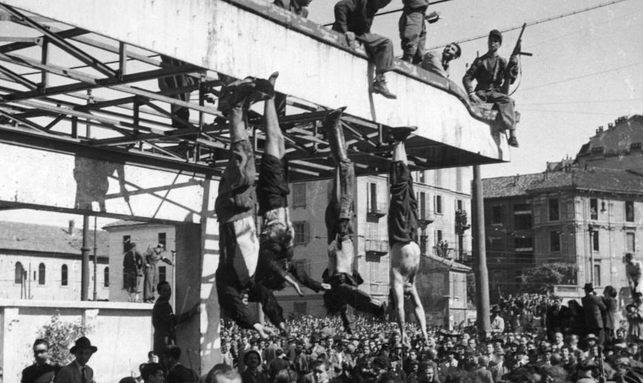 In the picture, they, Mussolini and other fascists were hanged by the Italian resistance.