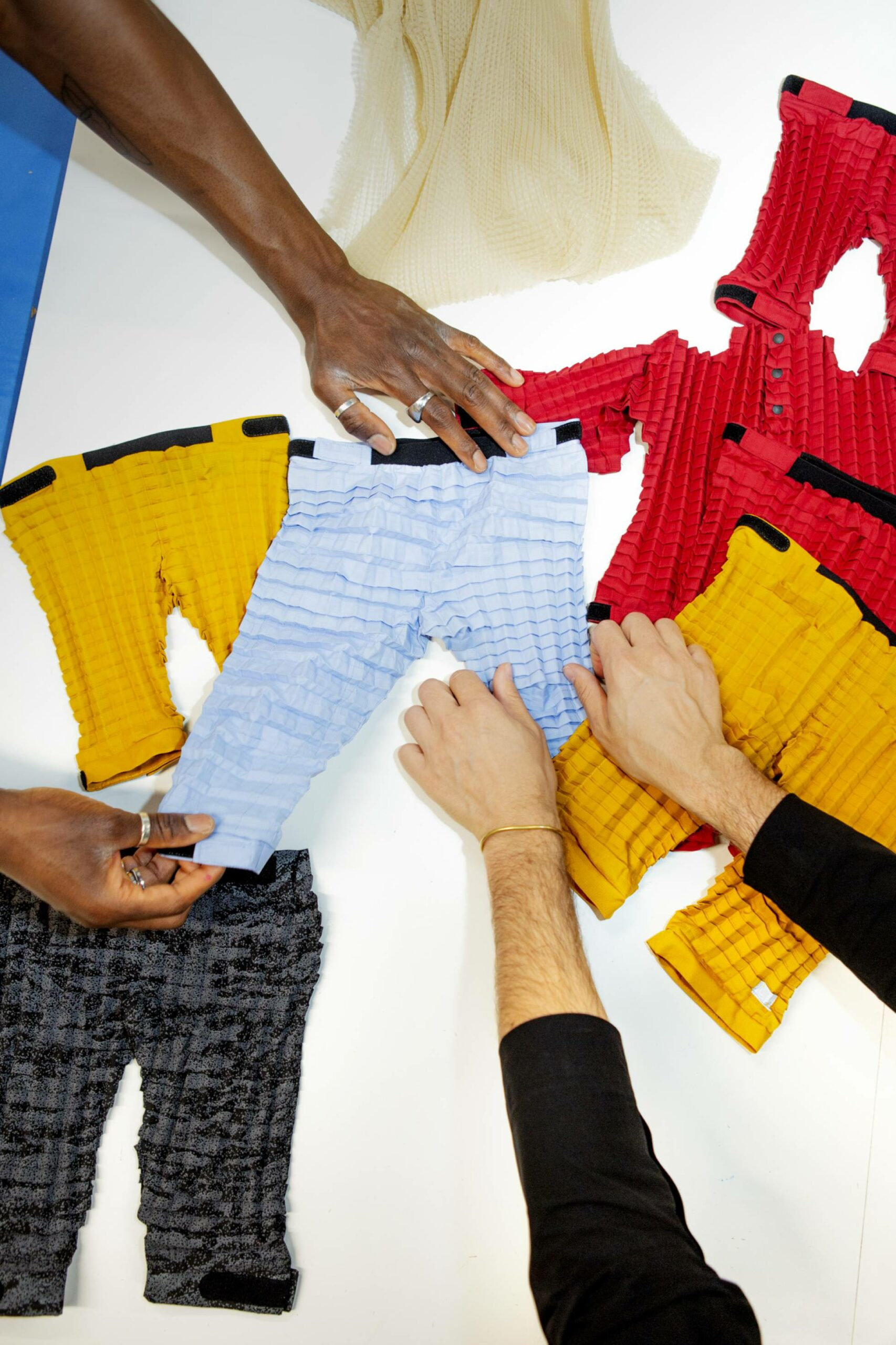 Clothes that stretch and fit many sizes were created thanks to the inventor's technical knowledge.